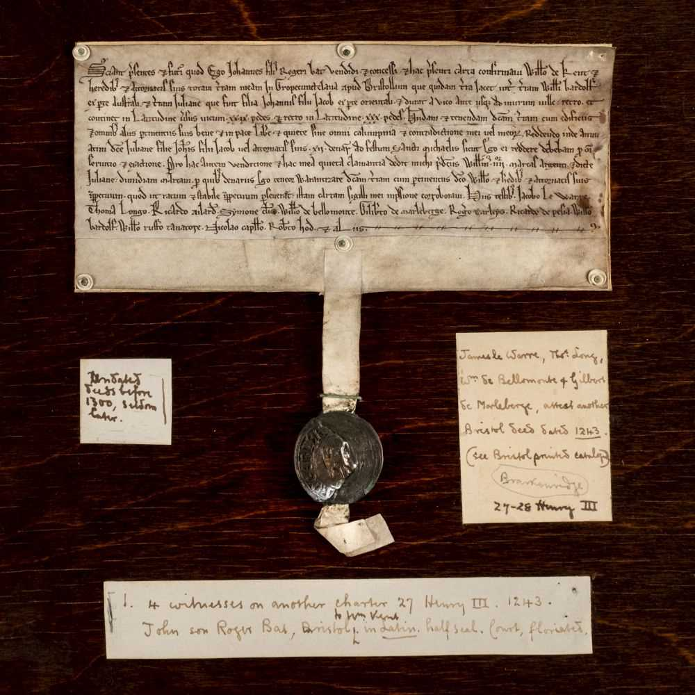Medieval deed: Gropecunt Lane, Bristol. Vellum deed in Latin written in a very neat court hand, John son of Roger Bat to William de Kent, all his land with the buildings in Gropecunttelana at Bristol (Bristolla) (S: land of William Bardolf; E: land of Julian who was the daughter of John the son of Jacob; from the street in front (29 feet) to the town wall behind, where it is 30 feet broad), paying a yearly quitrent of 12 pence to Julian who was the daughter of John the son of Jacob as John the grantor has been accustomed to pay of the consideration, 4 marks (£2 13s 4d) paid to John and and half a mark (6s 8d) to Julian